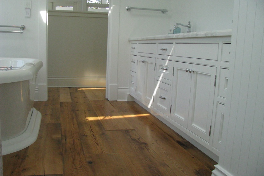reclaimed wood floors in the master en suite