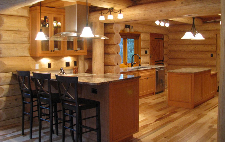 Log home kitchen features vertical grain douglas fir cabinets